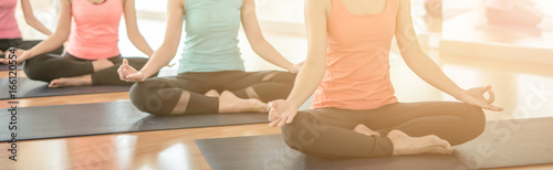 Poster School de yoga woman group exercising and sitting in yoga lotus position in yoga classes