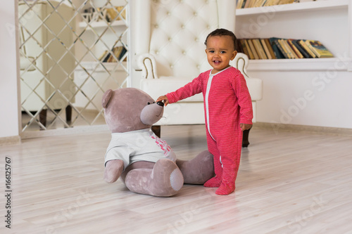 Fototapeta Portrait of smiling mixed race baby at home obraz na płótnie