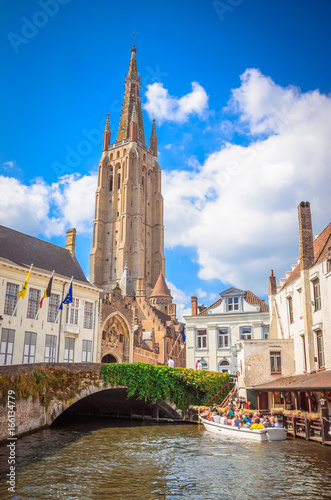 Wall Murals Bridges Church Of Our Lady and traditional narrow streets in Bruges (Brugge), Belgium