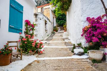 Fototapeta Narrow street in the village of Kritsa near Agios Nikolaos, Crete, Greece
