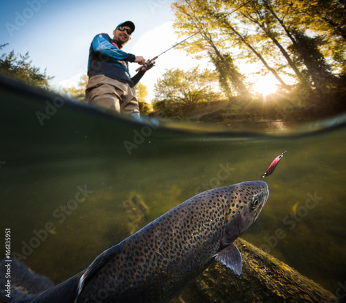 Printed kitchen splashbacks Fishing Fishing. Fisherman and trout, underwater view