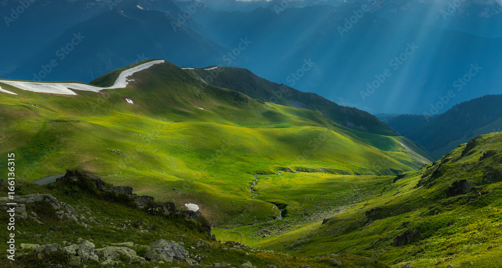 Fototapety, obrazy: Green river valley in beams of evening sun. Caucasus mountains.