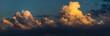 Leinwandbild Motiv Cumulus clouds on sunset sky.