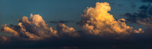 Cumulus Clouds On Sunset Sky.