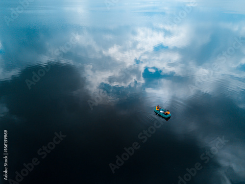 Aerial view of the lake with one fishing boat