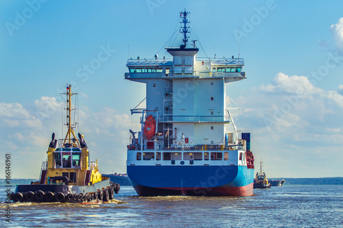 Tuinposter Industrial geb. Merchant ship. Posting vessels on the fairway. Tow. Marine navigation.