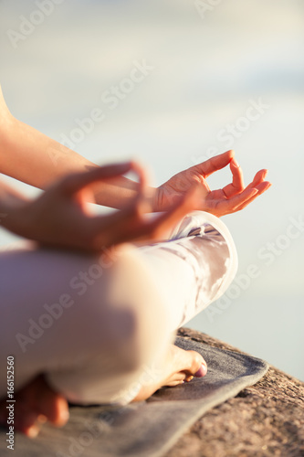 yoga woman meditating outdoors