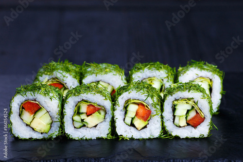 Photo Vegetarian sushi menu. Rolls with cucumber, avocado and tomato
