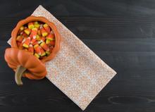 Candy Corn In Ceramic Pumpkin With Napkin