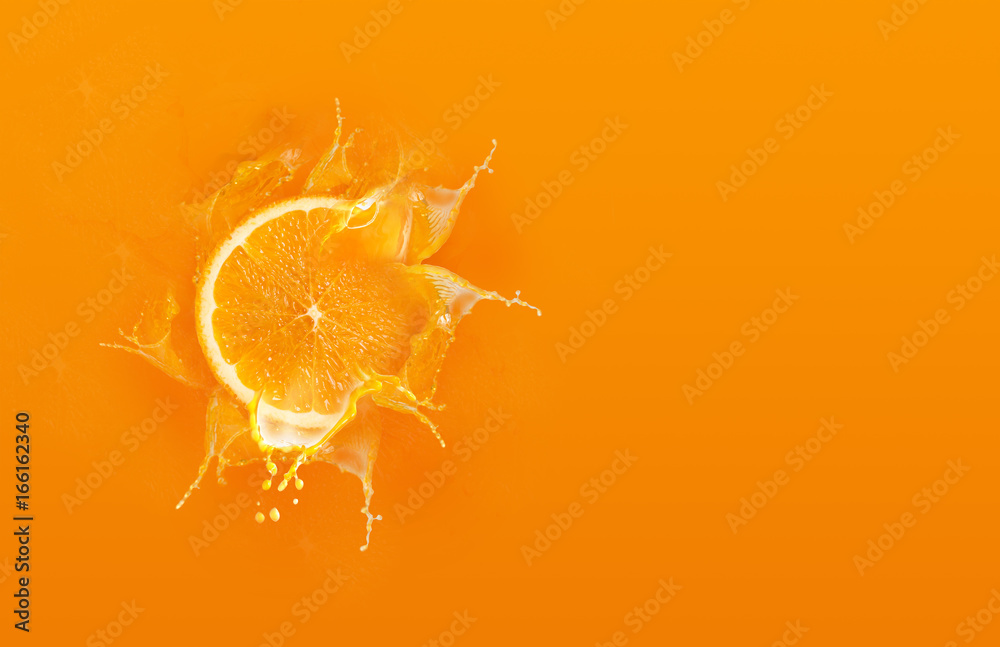 Fototapety, obrazy: Slide cut piece of orange drop on orange background with orange juice splash water with copy space