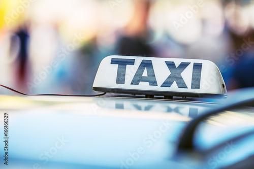 Fotografie, Obraz Taxi car waiting passengers in town