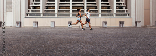 Foto auf AluDibond Jogging Man and woman running in the morning