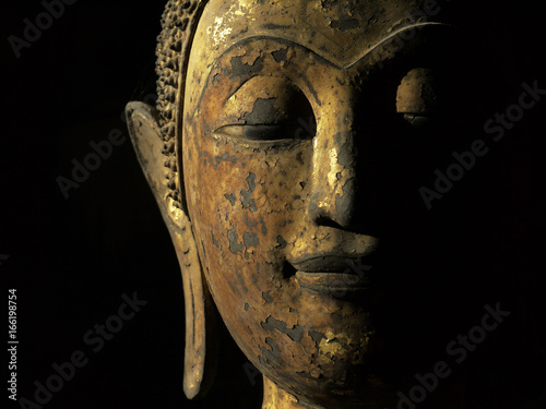 Photo  old gold buddha face