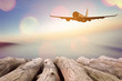 Airplane flying over tropical beach smooth wave and sunset sky abstract background.