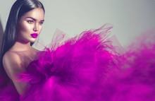Gorgeous Brunette Model Woman In Purple Dress Posing In Studio