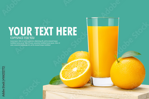Poster Sap Glass of fresh orange juice on wooden box, Fresh fruits Orange juice in glass with group on blue background with copy Space for your text.