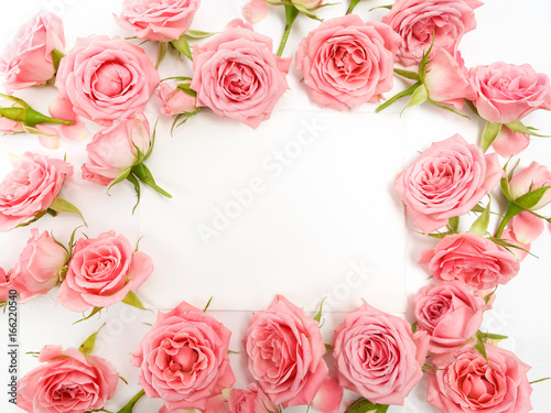 Framework from roses on white background. Flat lay, top view © vetre