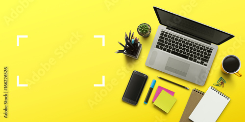 Office workplace with laptop, notebook, office supplies and stationery on yellow background. Solution, business planning, creative, design, learning, start up or working flat lay top view concept.