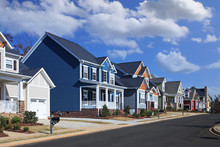 Generic, Colorful Houses On Suburban Neighborhood Street On A Sunny Day