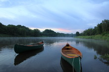 Canoe On River In Canada Sunrise