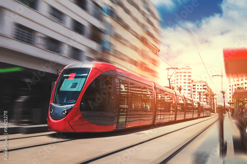 Fotografie, Obraz a tram passing on the railway in a sunny day - Casablanca - Morocco