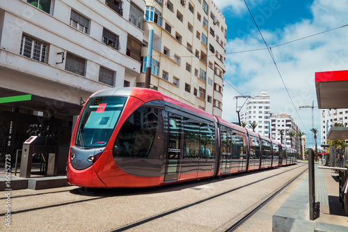 a tram passing on the railway in a sunny day - Casablanca - Morocco Fototapeta