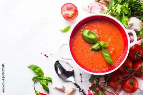 Tomato soup  on white. Top view copy space.