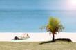 Tourist girl sunbathing and sleep on the coconut beach