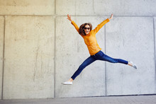 Joyful Young Lady Jumping And ...