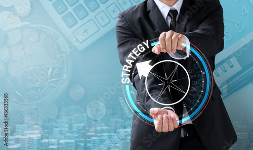 Fototapeta business man drive compass to strategy obraz