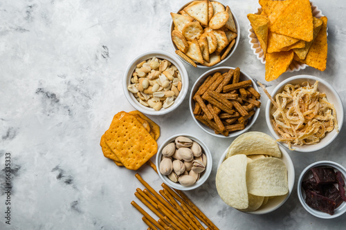 Canvas Prints Buffet, Bar Salty beer snacks in whit bowls