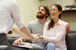 Portrait of young man and woman smiling happily thanking psychiatrist at couples counseling session