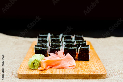 Foto  Japanese food Sushi Roll Maki of Salmon and avocado