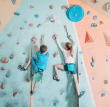 Two Children Climbing In Gym.