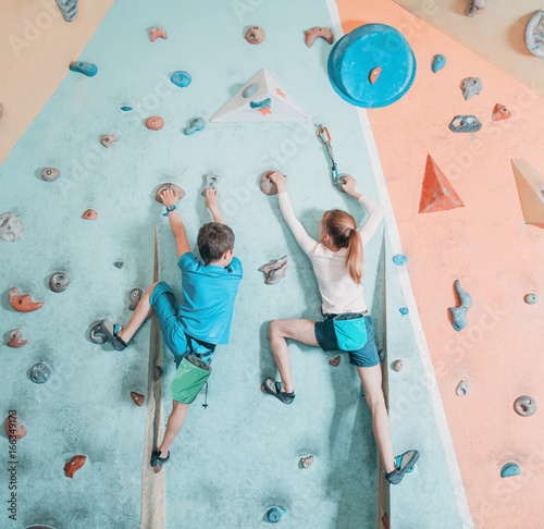 Fototapeta Two children climbing in gym. obraz