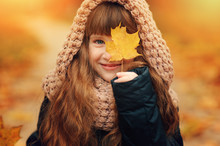Autumn Outdoor Portrait Of Beautiful Happy Child Girl Walking In Park Or Forest In Warm Knitted Scarf