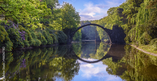 Vászonkép Bridge in rhododendron park in Kromlau, Germany