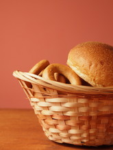 Buns And Bagels In A Wicker Basket