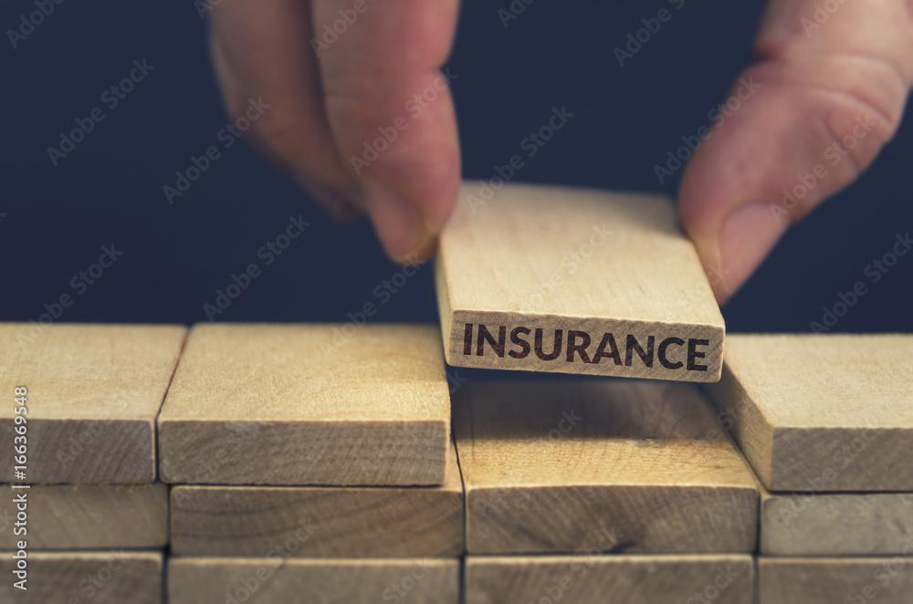 Insurance word written on wood block