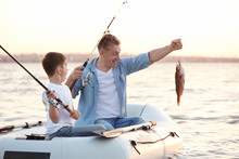 Dad And Son Fishing From Infla...