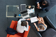 Overhead Shot Of Group Of Corporate Business People Having A Meeting