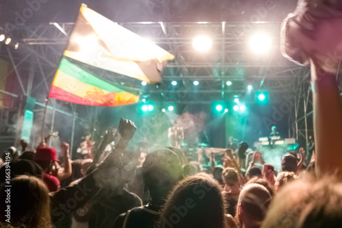Reggae concert with jamaican flags and cheering crowd Wallpaper Mural