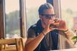 A man eating a vegan burger.