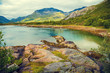 Mountain lake in the evening light. Fjord at sunset. Rocky shore in evening. Beautiful nature of Norway. Lofoten islands
