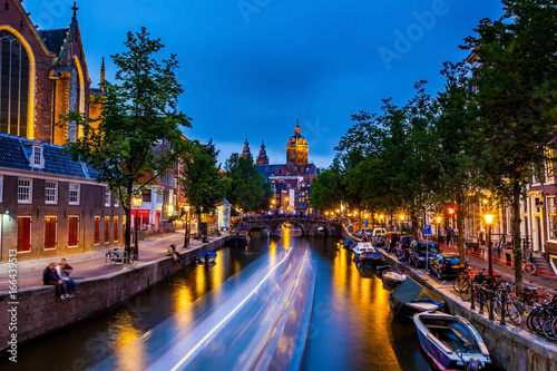 Photo  Light streak along canal through bridge, in front of Amsterdam castle