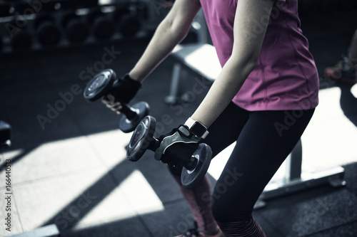 Foto op Plexiglas Fitness Asian woman work out weight training and listen music and wellness and sport concept and soft flare filter and cross process