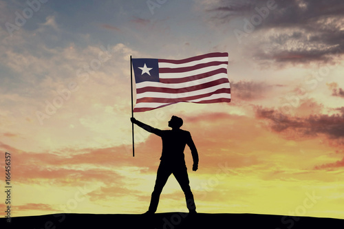 Male silhouette figure waving Liberia flag  3D Rendering