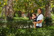Father walking with baby in park