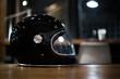 glossy black helmet on table