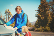 father with little daughter travel by car on road in mountains